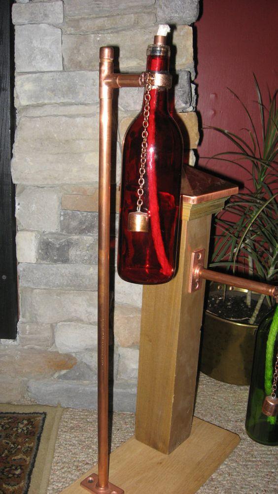 Wine bottle tiki torch tiki torches and wine bottles on for Diy beer bottle tiki torches