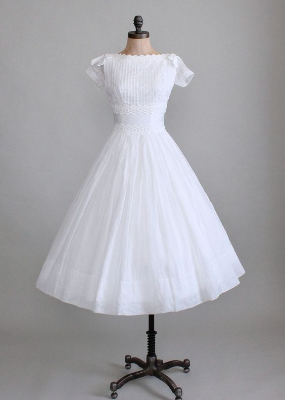 Vintage 1950s White Organdy Wedding Dress from Raleigh Vintage   Snap this one up!  The pleats and bows are stunning!