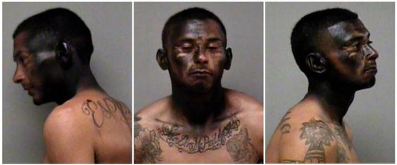 This combo of booking photo released by the Madera Police Department shows  23-year-old Jose Espinoza, who was arrested Saturday night, March 14, 2015. Espinoza, a suspected car thief, spray-painted his face black in an attempt to evade the police. Police booked Espinoza into the Madera County Department of Corrections, where he remained Monday morning, March 16. It was not immediately known if he has an attorney. (AP Photo/Madera Police Department)