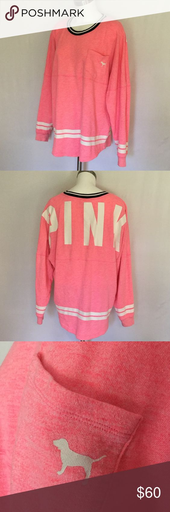 Victoria Secret Pink Varsity Crew 🍂 Victoria Secret Pink Crew Neck in bright pink with white and black stripe details. Right front pocket with pink graphic dog. Pink graphic on back of oversized light weight sweatshirt fabric. Very soft terry fabric. It is a longer oversized tunic style with back shirt round bottom. Looks awesome with leggings or skinny jeans. Size Large. Great condition. PINK Victoria's Secret Tops