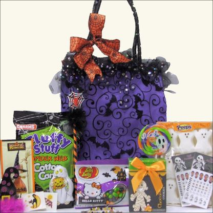 """Sparkly Spooky Fun Halloween Gift Basket - Tween Girl Ages 9 to 12 If you're wondering what to give that special """"tween"""" girl for Halloween, this sparkly and spooky fun gift basket could be just the answer. We've taken a fun Trick or Treat Bag with Sparkles and Tulle Fringe, and filled it with a variety of gifts to make her smile. Halloween-themed candies, chocolates and cookies including Peeps, Cotton Candy and Hot Chocolate keep things sweet, but that's not all we've got in store."""