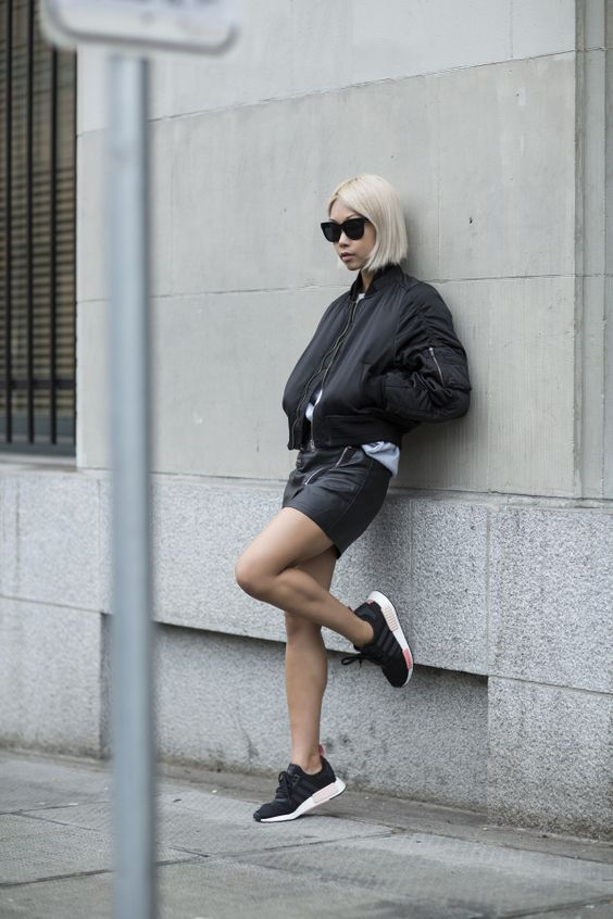 The black bomber jacket is an absolute classic. Vanessa Hong rocks this style, pairing it with a leather wrap skirt and black adidas trainers. If you want to replicate this edgy and alternative style, simply match a black bomber and a leather item. Brands not specified.