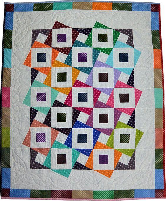 Quilt réalisé avec 1 Quilt Roll Pois & Moi et du tissu blanc. Les blocs sont coupés avec la règle X-Blocks Basix. Envoi des explications par email sur demande pour tout achat d'1 règle X-Blocks Basix et d'1 roll.: