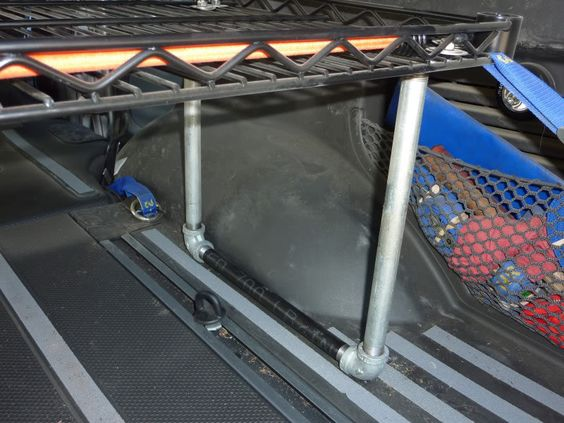Rear cargo shelf