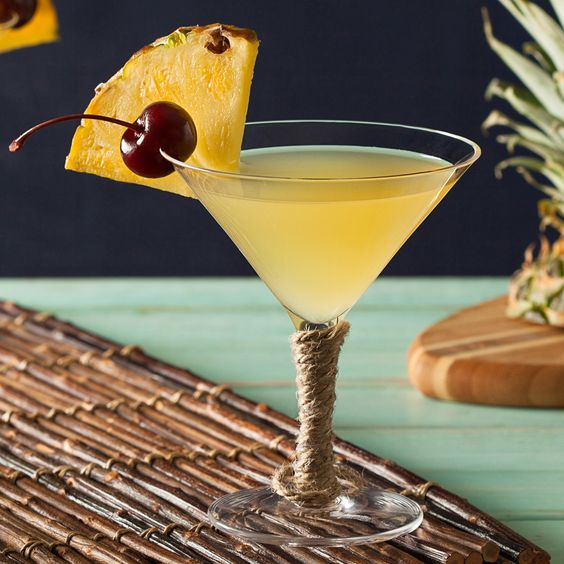 Enjoy a double blast of tropical flavors with this Pina Colada Martini recipe. Fresh pineapple and coconut flavors combine to bring a taste of the island to any gathering - from outdoor parties to hanging out with friends.