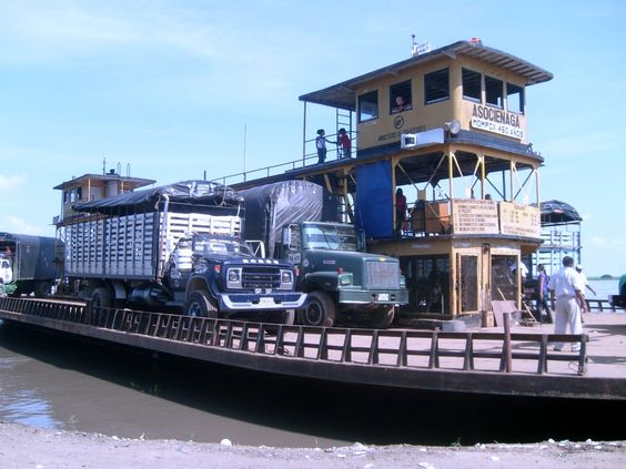 Ferry boat used with several trucks crossing the river to get to Mompox by bus