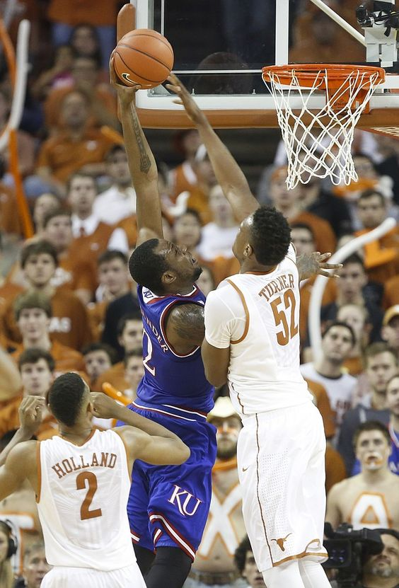 Kansas forward Cliff Alexander (2) attacks the bucket as he is fouled by Texas forward Myles Turner (52) during the second half, Saturday, Jan. 24, 2015 at Frank Erwin Center in Austin, Texas.