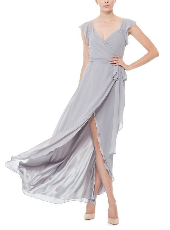This long, wrap style Joanna August bridesmaid dress has flutter sleeves and v-neckline. The Dorian Long is made of chiffon with ties that wrap around the natural waist.Skirt rounds up in the front to create a high-low hemline.