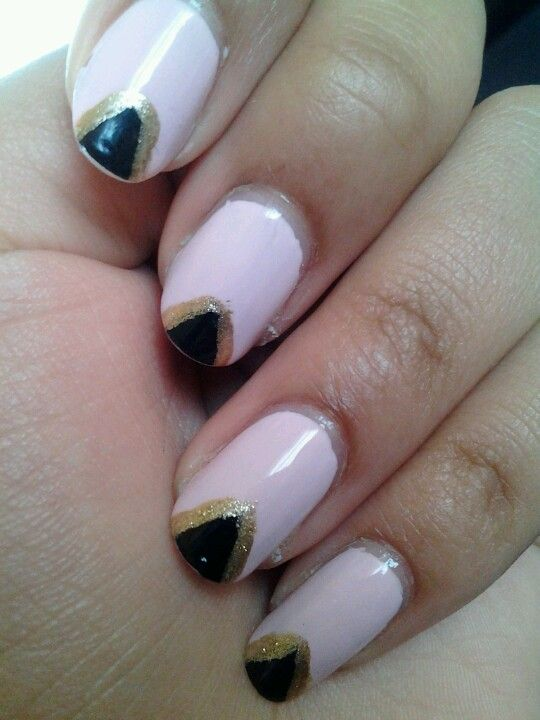 Pink, black,  and gold nail design.