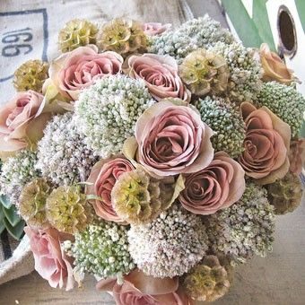 unusual BQ with white allium, scabiosa pods and roses