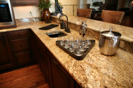 The dark cabinets here work well with the darker granite and turning it into an island/bar besides really dresses things up. You get a little of that ritzy color and style through the next room as well.