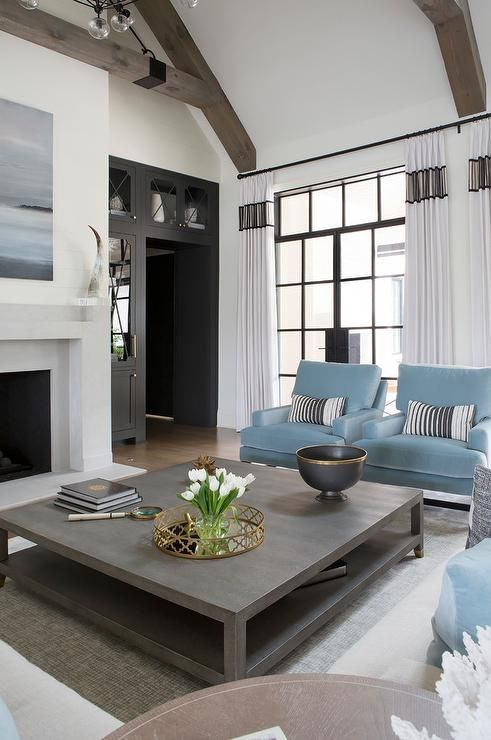 Powder Blue Accent Chairs Topped With Black Striped Pillows Sit On A Gray Rug Facing A Grey Wood Coffee Table Quality Living Room Furniture Blue Accent Chairs #striped #living #room #chairs