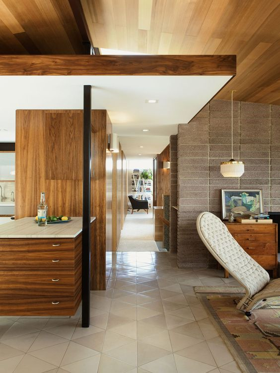 Mid Century Revival by The Archers . The house was in disrepair and was torn down to the steel frame and fireplace.