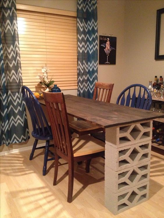 Done! Wood, stain and cinder blocks from Home Depot. Chairs from goodwill and painted the two blue myself. And I finally have a dining room table!