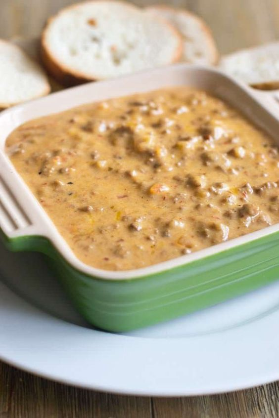 Easy Hamburger Dip with Real Cheese - The perfect game day dip or appetizer, made with REAL cheese. Get the recipe from COOKtheSTORY