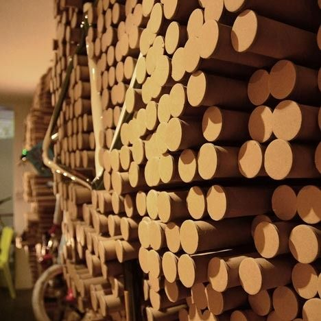 bicycle shop in Hong Kong features a display wall made from 5,412 recycled paper tubes that can be pushed in and out as needed to cradle, hang, or provide support to the store's products