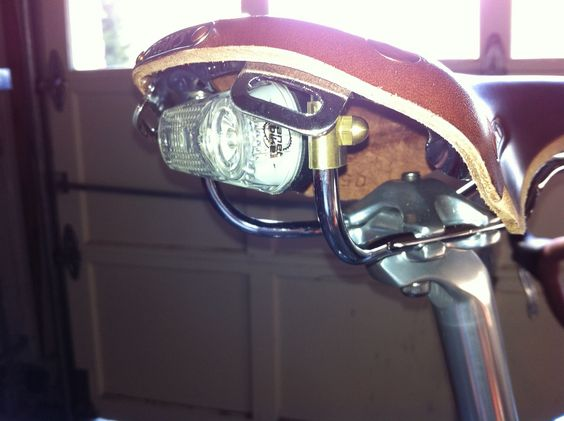 Side shot showing the brass domed nut which clamps the mount to the saddle rails.