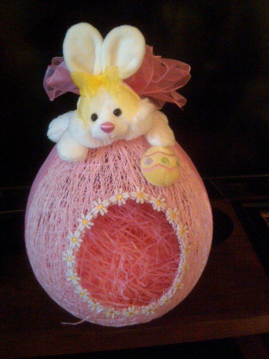 Hollow out easter baskets and make an easter scene inside.  Cute idea.  Big balloon needed.
