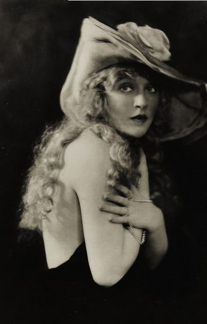 "Mae Murray (May 10, 1885 – March 23, 1965) was an American actress, dancer, film producer, and screenwriter. Murray rose to fame during the silent film era and was known as ""The Girl with the Bee-Stung Lips"" and ""The Gardenia of the Screen""."