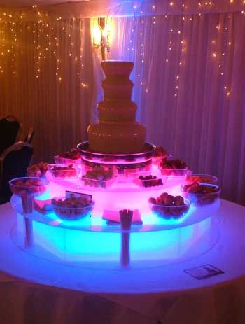 """OH YUM as if the chocolate fountain wasn't enough, add a bunch of LED submersibles below the edibles to make your guests """"ooooo"""" & """"aaahhh"""": http://www.flashingblinkylights.com/advanced_search_result.php?keywords=11446=0=0"""
