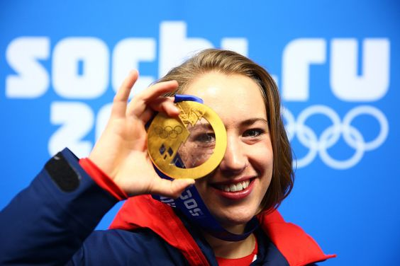 Description of . SOCHI, RUSSIA - FEBRUARY 15:  Gold medalist Lizzy Yarnold of Great Britain celebrates during the medal ceremony for the Wom...