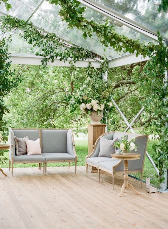 Elegant garden wedding venue with stylish wedding lounge in greenhouse