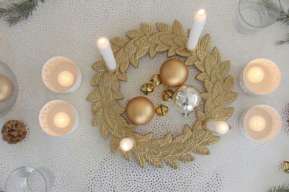 My neutral Swedish farmhouse Christmas tablescape with white, gold, and green, ready for its Swedish pancakes. #hellolovelystudio #christmasdecor #whiteandgold #adventwreath #tablescape