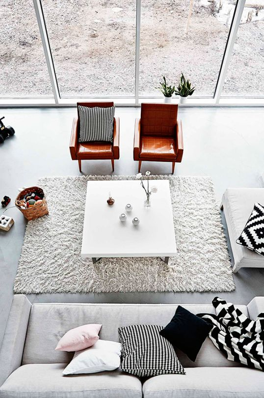open plan living room | leather seats | grey sofas | monochrome interiors