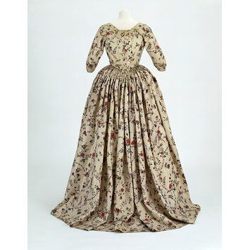 Robe a L'Anglaise. 1780. Back view. Netherlands of Indian cotton. Resist- and mordant-dyed, block-printed, painted and lined. (T.217-1992). The printed gold spot pattern would have been applied to an adhesive, probably gum arabic, after the chintz fabric had been painted and dyed.