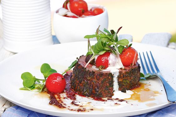 Herb-crusted beef with confit cherry tomatoes