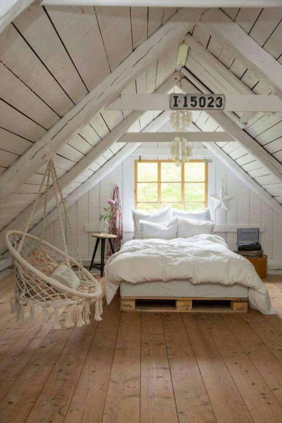 Cozy country attic bedroom with white wood material. #farmhouseatticsbedroomideas #vintageBedroom