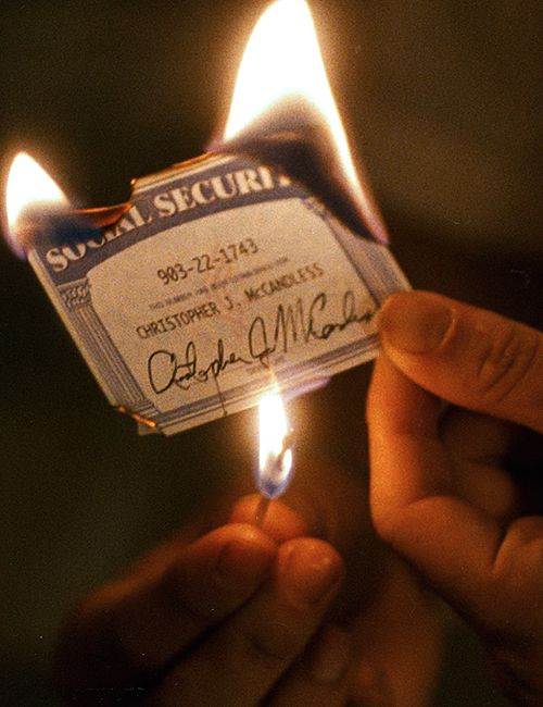 In attempt to seperate himself from society, Chris burns his Social Security card during his trip.