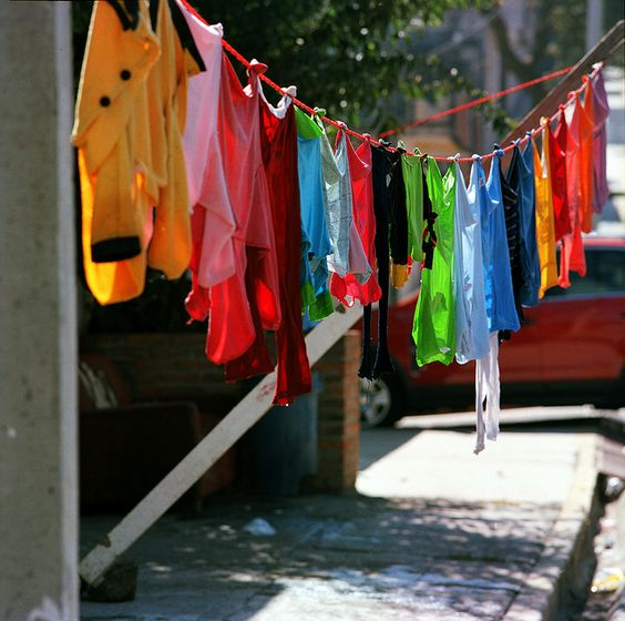 rainbow of colorful clothes on the line