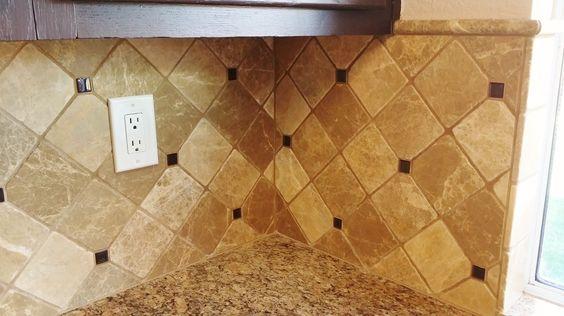 Marble tile backsplash- look how the tile wraps around the corners