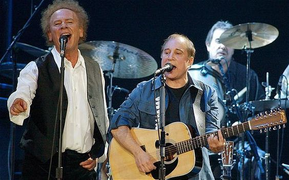 Paul Simon, right, and Art Garfunkel perform in this, Oct 16, 2003 file photo, in Wilkes-Barre, Pa., during a warmup show for a 40-date tour, their first tour together since 1982-83
