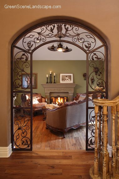 Arched iron scroll doorway dream home pinterest for Designs of arches in living room