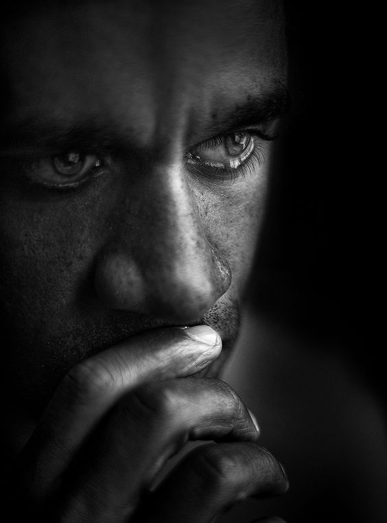 Powerful face, intense expression, hand, insecurity, man, male, intense, powerful, portrait, photo b/w.: