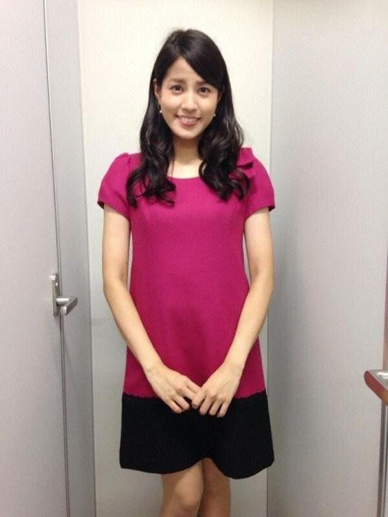 ピンクのワンピースを着用する永島優美