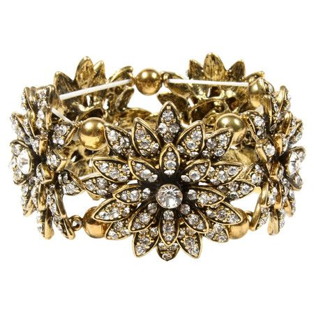 Perfect for day or night, this elegant stretch brass bracelet features Austrian crystal flowers and an antique gold finish.  Product...