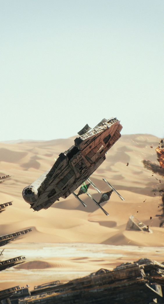 """The chase scene with the Millenium Falcon and a couple of TIE fighters in """"Star Wars-The Force Awakens"""" (2015)"""