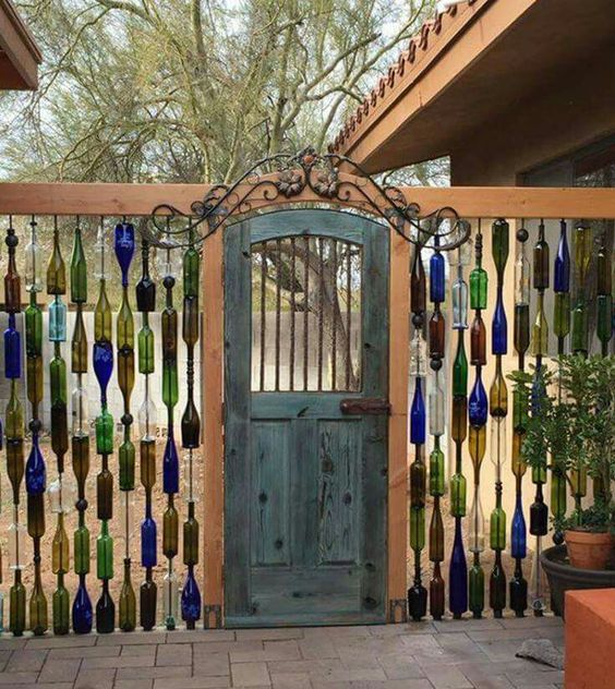 Wine bottles fence. Love this,,  you can paint the plastic paint over the bottles to prevent breaking.