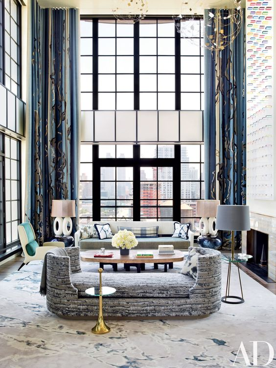 Interior designer Jean-Louis Deniot created a lyrical New York pied-à-terre for a family based in Paris and Aspen, Colorado; SPAN Architecture collaborated on the structural work. In the double-height living room, a Deniot-designed daybed covered in a Métaphores fabric and accented by an Hermès throw is joined by several vintage pieces, including a FontanaArte side table (in the foreground), an Ado Chale cocktail table, and an Edward Wormley sofa. The artwork above the fireplace is by Mauro…