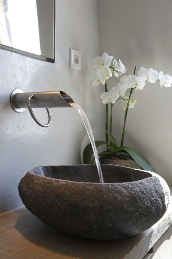 Gorgeous stone sink, lively wooden bench, and gorgeous tap...