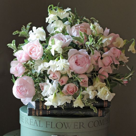 Heavenly scented ivory English Sweet Peas and Peony Pink roses this bouquet is a real treat for the senses. #sweetpeas #gardenroses  http://www.realflowers.co.uk/pastel-pink-ivory-sweet-pea-rose-bouquet.html