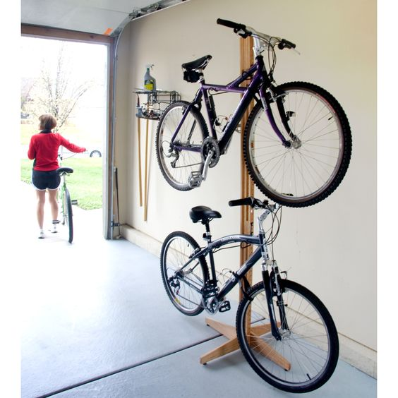 The Gear Up Oak Rak Bike Freestand is made of American red oak and has a hand rubbed oil stain and finish. The solid oak top plate uses compression foam to protect the ceiling and the solid oak base plate provides stability on any surface.