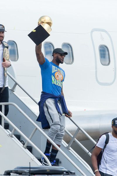 LeBron James Photos - LeBron James #23 of the Cleveland Cavaliers hoists the trophy as he gets off the plane as the team returns to Cleveland after wining the NBA Championships on June 20, 2016 in Cleveland, Ohio. - 2016 NBA Champion Cleveland Cavaliers Airport Arrival
