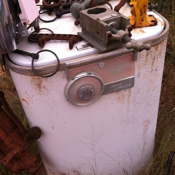 Rusting dishwasher circa Donna Reed