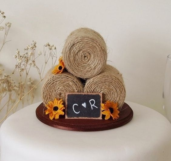 Sunflower Haybale Cake topper! Don't forget monogrammed napkins to match! #countrywedding #sunflower www.napkinspersonalized.com