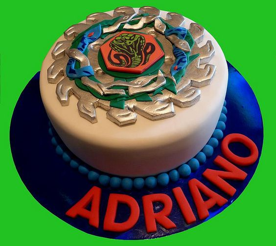 This is probably the best looking one so far. It looks the most realistic. Beyblade Cake by Cre8acake, via Flickr