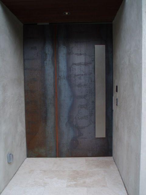 corten steel door + concrete wall + stainless steel handle
